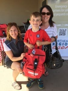 Fort Saskatchewan seven-year-old Tyson Broad and his mother Crystal pick up an emergency preparedness kit from Northeast Region Community Awareness Emergency Response (NRCARE) during Fort Saskatchewan's Emergency Preparedness Week event at Co-op on Tuesday, May 3.